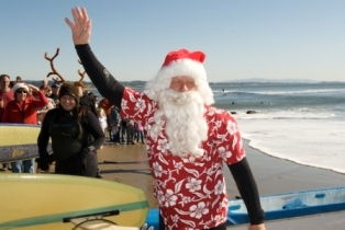 Surfing Santa waves to the crowd - Capitola Soquel Chamber of Commerce Capitola, CA